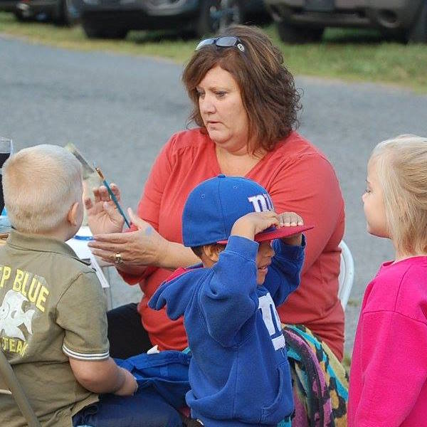Mrs. Terri Painting Faces at Family Fish Night